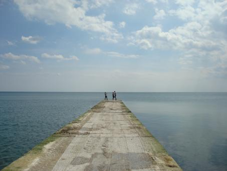 People on a sea dock - Free Stock Photo