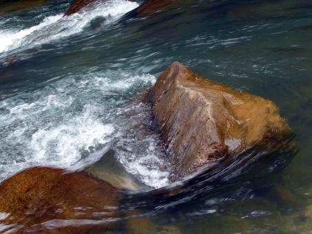 Water over smooth boulders in river - Free Stock Photo
