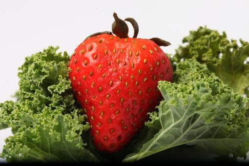Red Strawberry on kale - Free Stock Photo