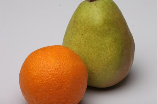 Orange and Pear isolated on white. - Free Stock Photo