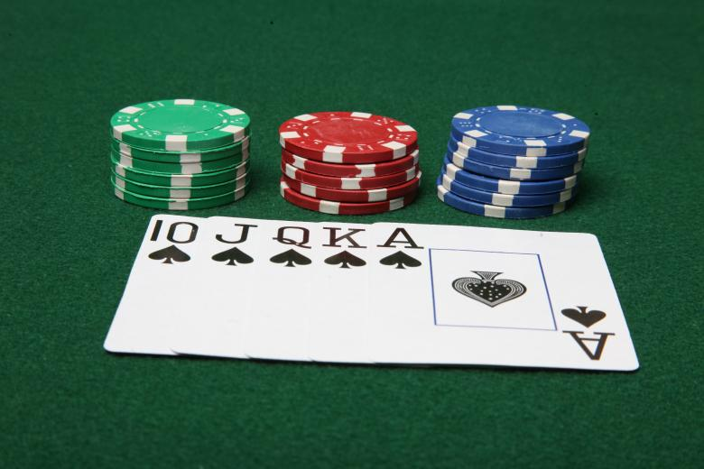Royal Flush with poker chips Free Photo