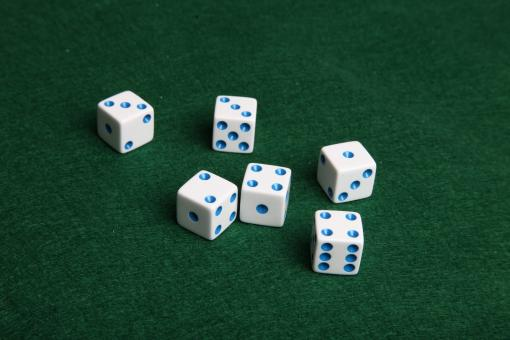 Dice on green felt table - Free Stock Photo