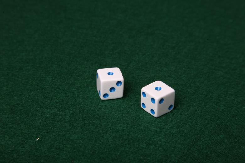 Free Stock Photo of Dice on green felt table Created by Jared Davidson