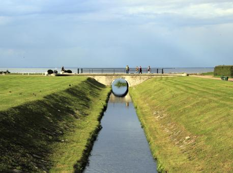 Water canal to the gulf and a bridge - Free Stock Photo