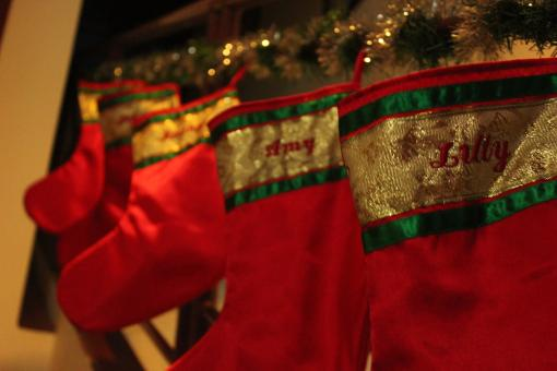 Red Christmas stockings hanging - Free Stock Photo