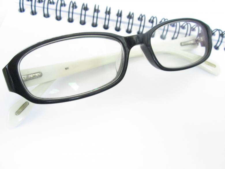Free Stock Photo of Eye Glasses with Book Created by Galayanee