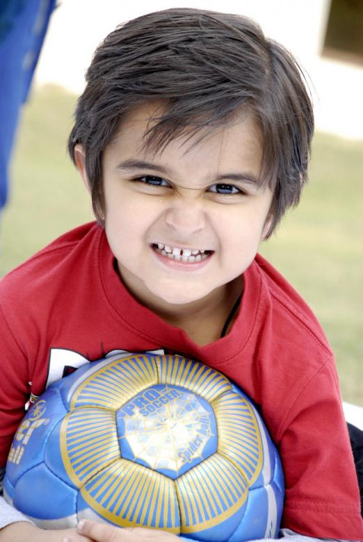 Free Stock Photo of Cute Kid With Football Created by Bilal Aslam