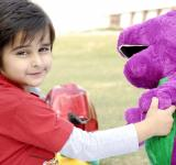 Free Photo - Cute Kid Playing with Dino