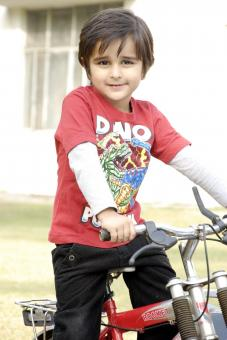 Cute Kid with Bicycle - Free Stock Photo
