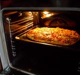 Free Photo - Pizza in oven