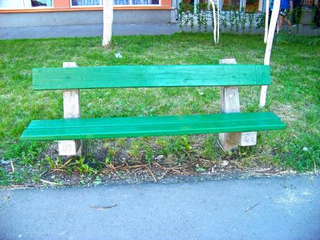 A green bench in a park - Free Stock Photo