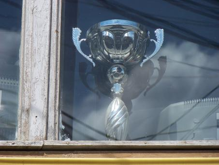 Trophy in window - Free Stock Photo