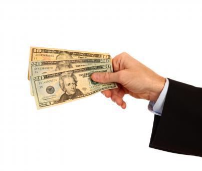 A Hand Holding Money - Free Stock Photo