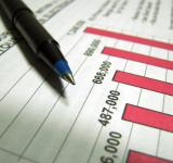 Free Photo - Closeup of a tax income graph and pen
