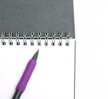 A pad of paper and a pencil isolated - Free Stock Photo