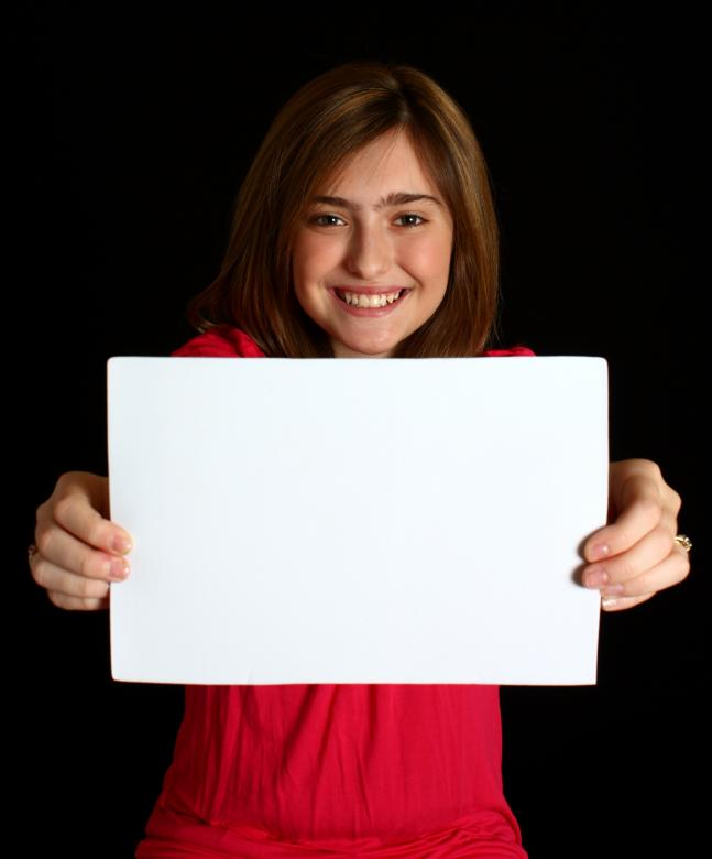 Free Stock Photo of A cute young girl holding a blank sign Created by Benjamin Miller