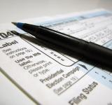 Free Photo - Closeup of a 1040 tax form and a pen