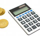 Free Photo - A calculator and a stack of gold coins