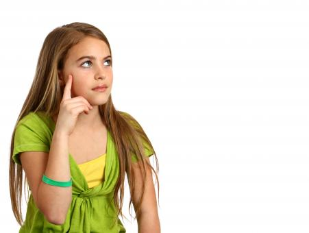Young girl with a thoughtful expression - Free Stock Photo