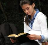 Free Photo - A young schoolgirl reading a book