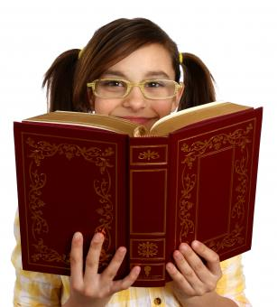 A smart girl with glasses reading a book - Free Stock Photo
