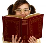 Free Photo - A smart girl with glasses reading a book