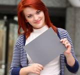 Free Photo - Young woman holding a blank card