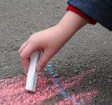 Free Photo - Child drawing with sidewalk chalk