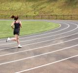 Free Photo - A cute young girl running on a track