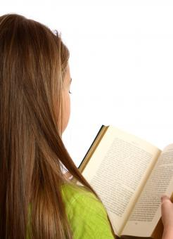 A beautiful young girl reading a book - Free Stock Photo