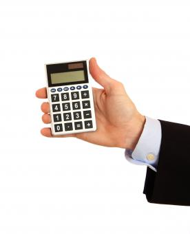 A hand holding a calculator - Free Stock Photo