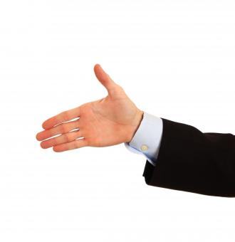 A hand being held out for a handshake - Free Stock Photo