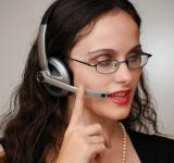 Free Photo - Business woman talking on a headset