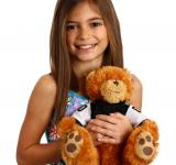 Free Photo - A pretty young girl holding a teddy bear