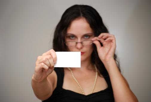 A beautiful woman holding a blank card - Free Stock Photo