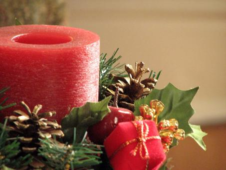 Closeup of a red Christmas candle - Free Stock Photo