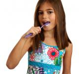 Free Photo - A pretty young girl brushing her teeth