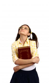 A smart girl with glasses holding a book - Free Stock Photo