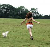 Free Photo - A cute young girl running with her dog