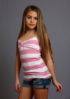 A beautiful young girl posing on gray - Free Stock Photo