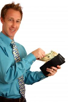 A young businessman holding a wallet - Free Stock Photo