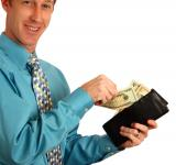 Free Photo - A young businessman holding a wallet