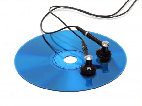A blue cd with headphones - Free Stock Photo
