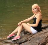 Free Photo - A beautiful young woman posing on a rock