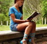 Free Photo - A beautiful teen girl reading a book