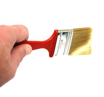 A hand holding a paint brush - Free Stock Photo