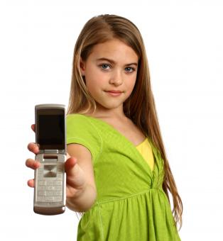 A beautiful young girl holding a cell - Free Stock Photo