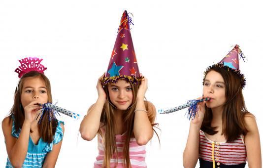 Three young girls celebrating a birthday - Free Stock Photo