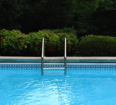 A ladder in a swimming pool - Free Stock Photo