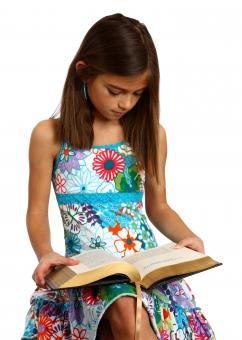 A pretty young girl reading a book - Free Stock Photo